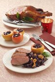 Duck with red cabbage and baked apple