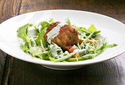Spicy pork fillet with a rocket salad