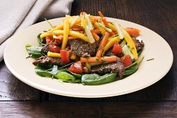 Beef with mango, vegetables and sesame