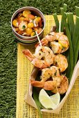 Prawn kebabs with physalis and tomato salsa