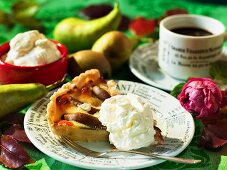 A piece of pear tart with cream