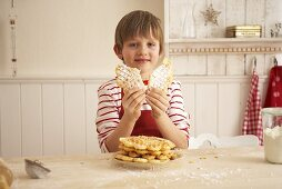 A child holding an advent waffle