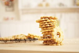 A stack of shortbread rings on a wire rack
