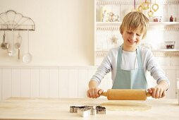 Child rolling out dough