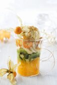 Exotic fruit salad with ice cream for Christmas