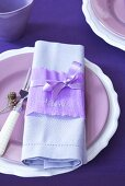 A place setting with crepe paper as a place card