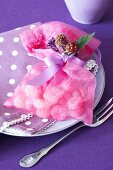 A guest present: a satin bag filled with blackberry sweets
