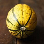Yellow and green striped pumpkin