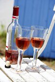 Rosé wine in glasses and bottle