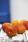Several apricots on garden chair