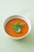 Cold tomato and orange soup with basil