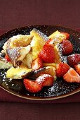 Scrambled curd cheese pancake with cranberries & strawberries