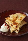 Apple pancakes with cranberry crème fraîche