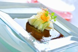 Steamed snow fish with papaya and cucumber in soy sauce