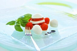 Tomatoes and mozzarella with basil
