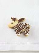 Reindeer biscuit with chocolate drizzle