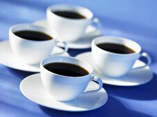 Four cups of black coffee