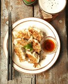 Fried pasta parcels with a glass of beer