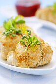 Stuffed turkey rolls with sesame seeds and herbs