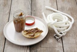 Anchovy fillets on bread roll