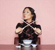 Asian woman with chopsticks