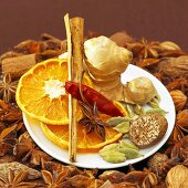 Christmas spices and dried orange slices on plate