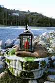 Floor cushion with lantern by river