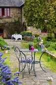Flowers on garden table and chair