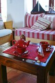 Tea things and maritime decorations on coffee table