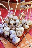 Marinated quails' eggs on cocktail sticks