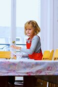 Little girl laying dining table