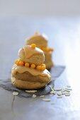 Profiteroles with honey cream, orange icing & flaked almonds