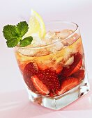 Strawberry punch with lemon juice and ice cubes