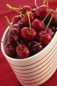 Cherries in a striped pot
