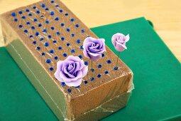 Purple sugar roses in a block of foam