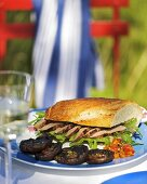 Duck breast sandwich and grilled mushrooms