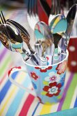 Cutlery in colourful mug