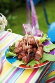 Bacon-wrapped sausages