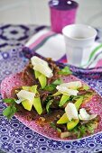 Bruschetta with beef carpaccio, avocado, walnuts & Parmesan