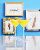 Lemon Martinis in front of pictures depicting England