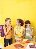 Three children at breaktime
