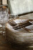 Antique plates, glasses, knives and forks