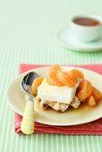 Waffles with ice cream and marinated mandarin orange segments