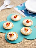 Vanilla cream tarts with small pieces of fruit