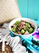 Spinach salad with grilled aubergine and lamb