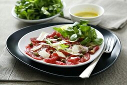 Beef carpaccio with capers, Parmesan and watercress