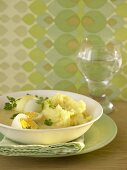Hard-boiled eggs in mustard sauce with mashed potato