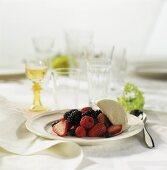 Fresh berries with vanilla ice cream