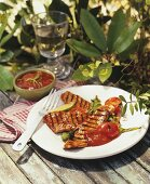 Grilled meat with tomato sauce and chillies