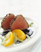 Pork fillet in spice crust with balsamic peaches